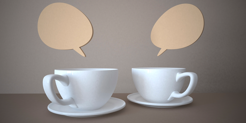 Two cups of tea with speech bubbles above
