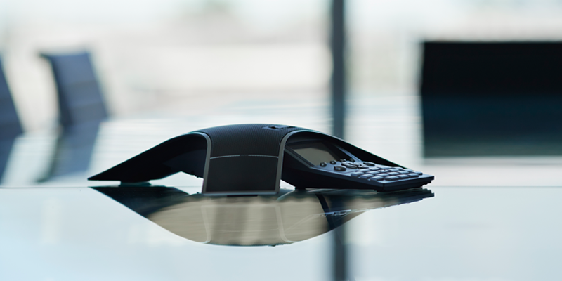 A conferencing phone in an office setting