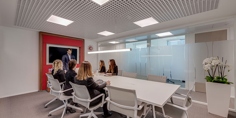 Employees sat round a large table in a Regus meeting room