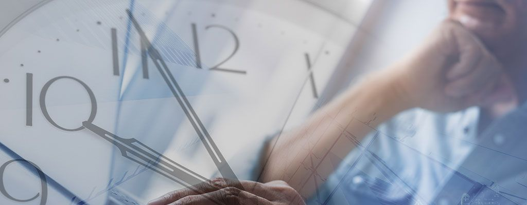 A large clock face with a man working