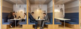 2 Men sat working in a co-working booth