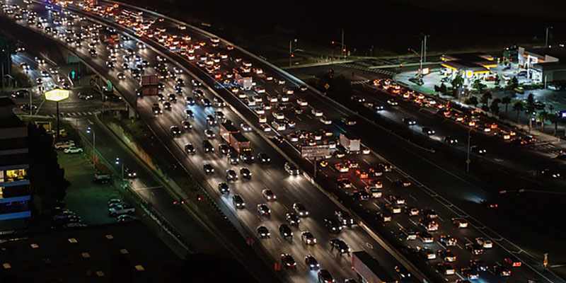 A busy motorway or freeway from afar, at night